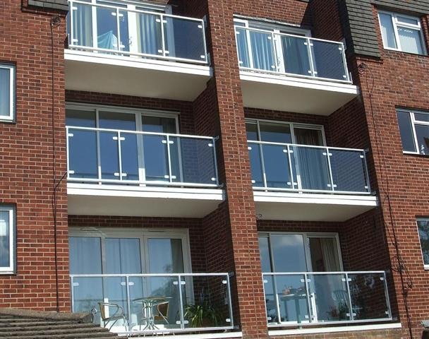 Glass Balustrade Behind Existing Railing On Balcony