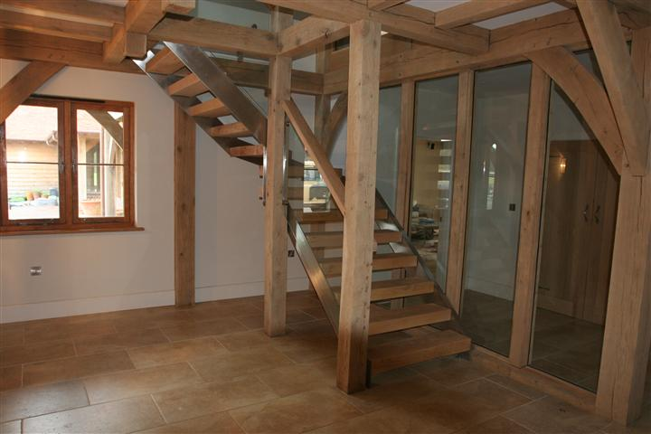 oak and stainless steel staircase bespoke made for client bespoke glass staircase